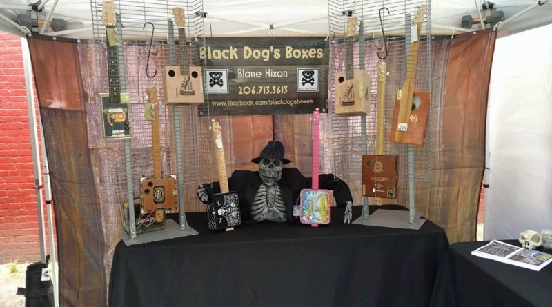 Cigar and lunch box guitar vendor Black Dog Boxes.